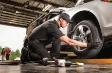 technician-fixing-tire-downey